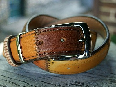brown leather belt made from baseball glove leather, silver hardware