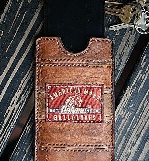 brown phone sleeve made from recycled nokona baseball glove leather